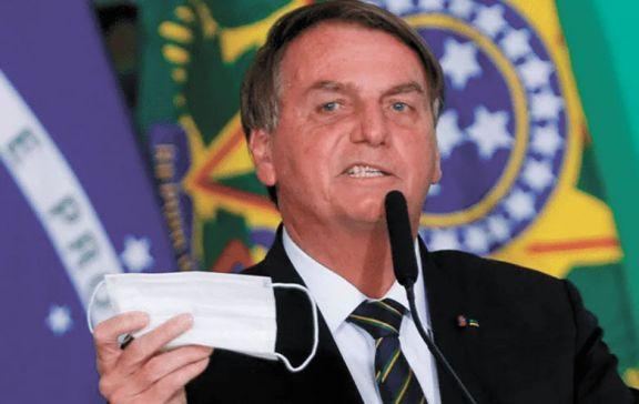 Bolsonaro se sacó el barbijo  e insultó a un periodista